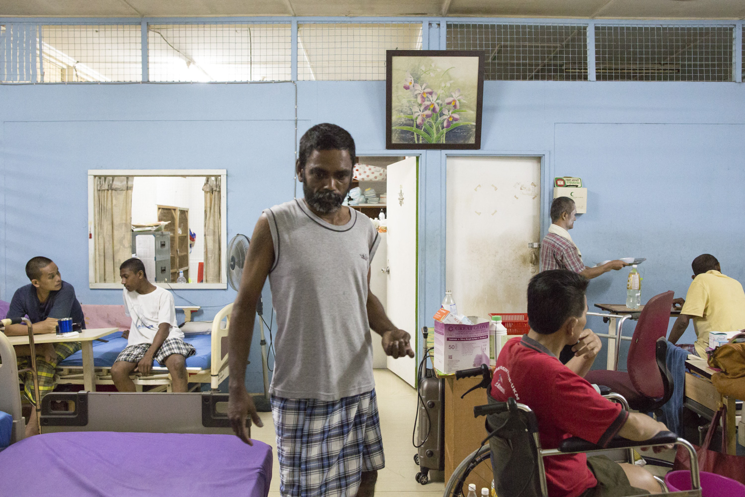A typical scene in the evening at the sick bay. Kumaran used to work in a law firm before being diagnosed with HIV. He moved to PLC's sick bay where he receives nursing care after developing a stroke.