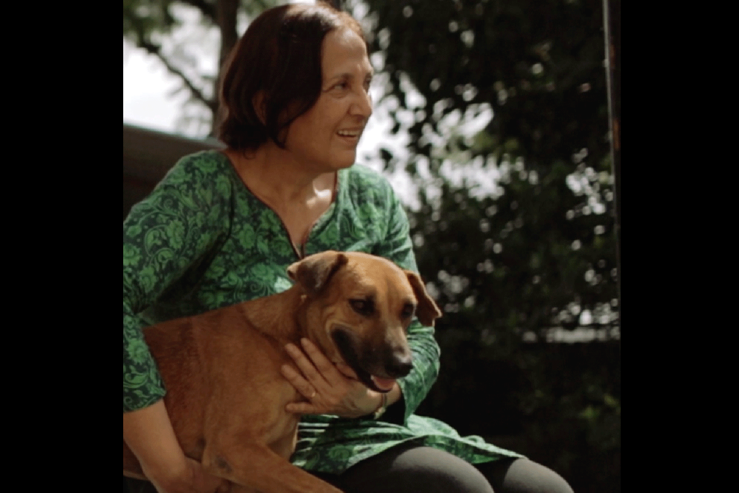 Meet Vivienne. She found her secret to happiness: dedicating her life to saving the street animals in India