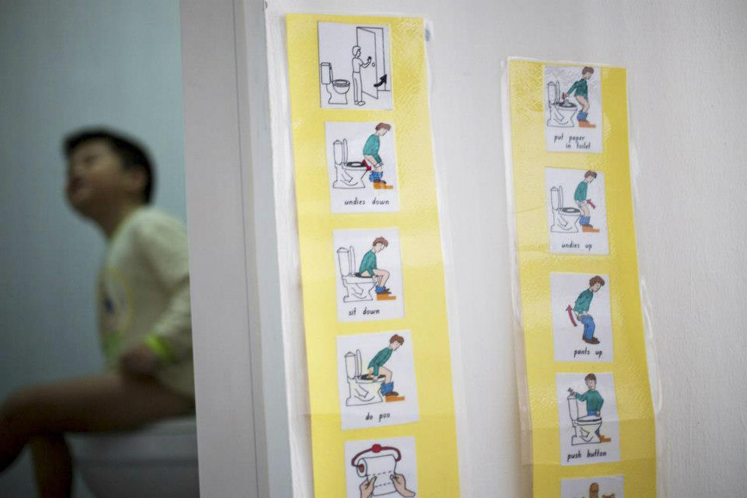 His occupational therapist prepares a set of instructions with pictures which we use to teach Jun Le how to use the toilet on his own and develop good personal hygiene habits.