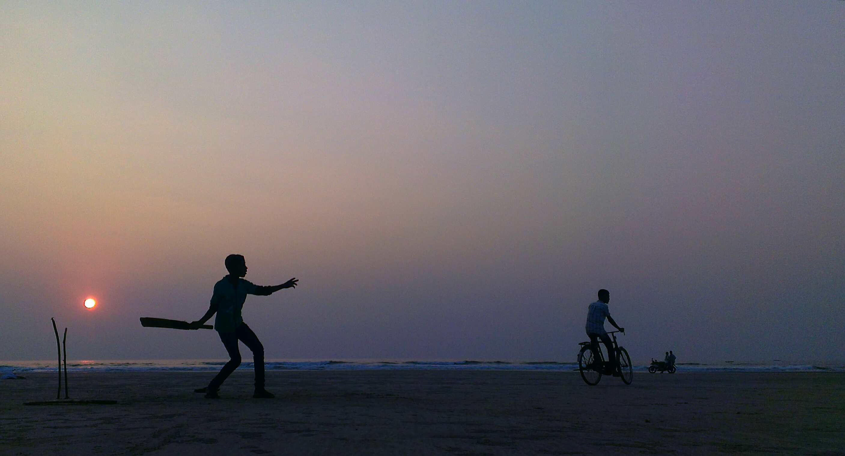 Day 11 playing cricket on the beach at sunset